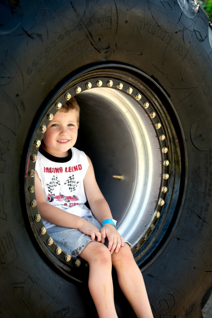 Touch a Truck Photo of boy in tire