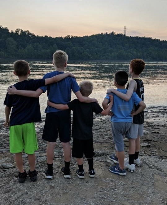 Kids by the lake/one wearing our shirt